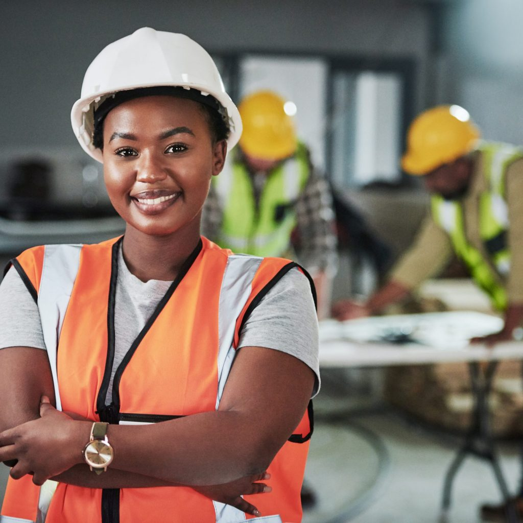 Portrait of a confident young woman working at a construction site