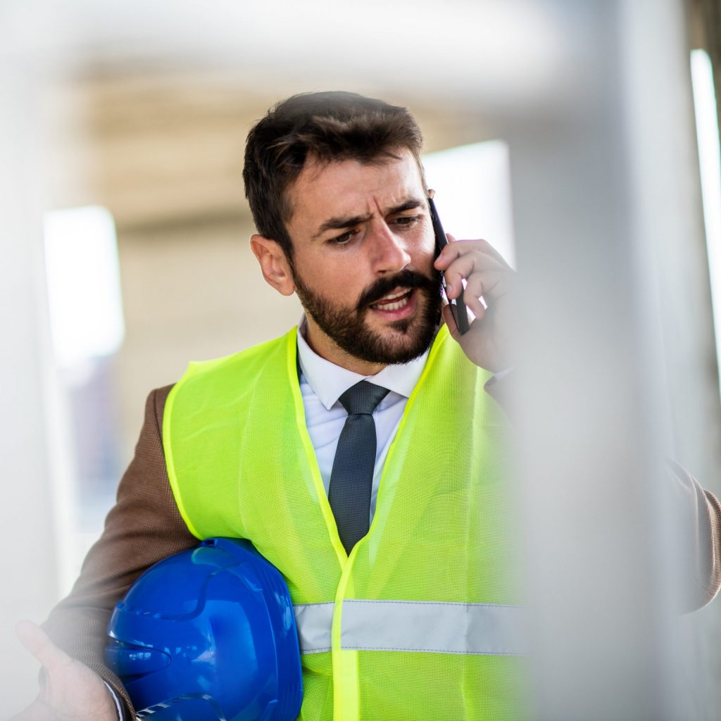 A construction engineer is speaking with his colleague on the phone about problems at the construction site and possible solutions.