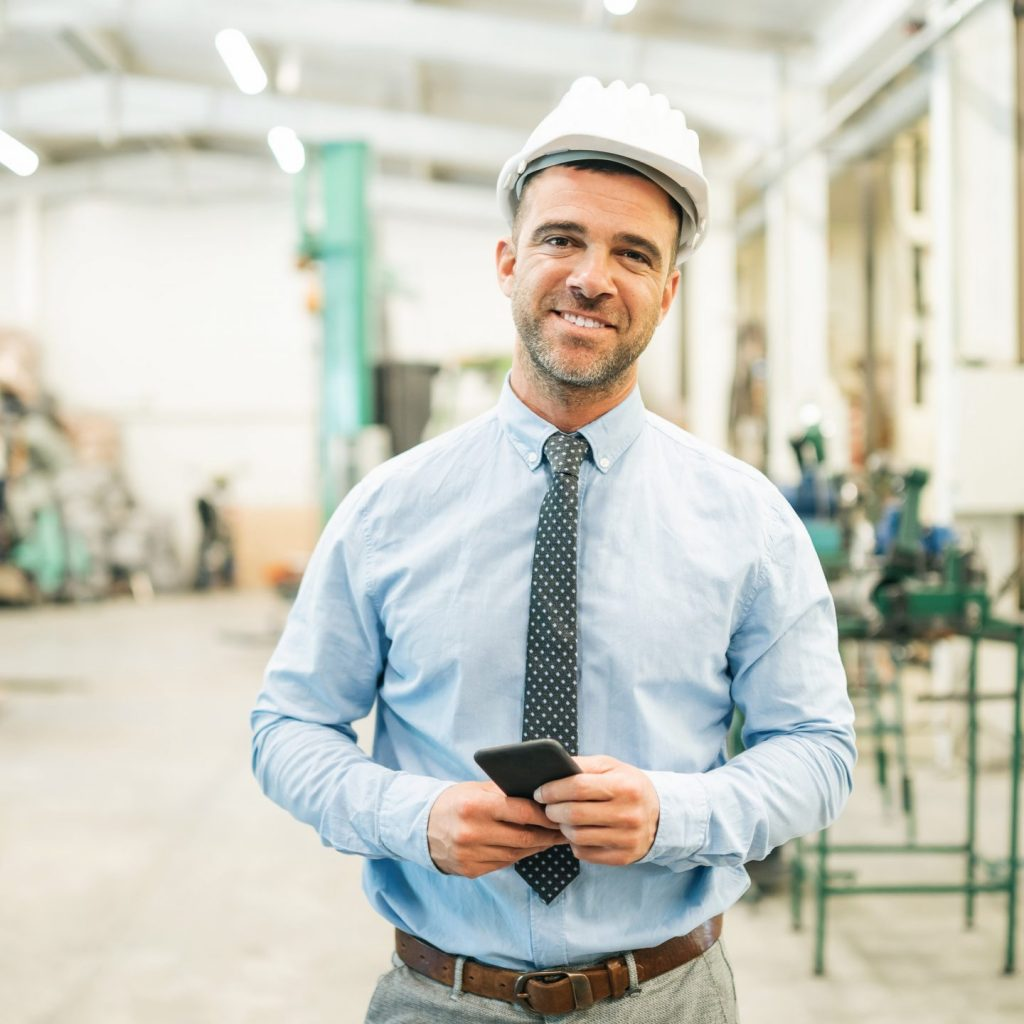 Businessman talking on phone in factory.